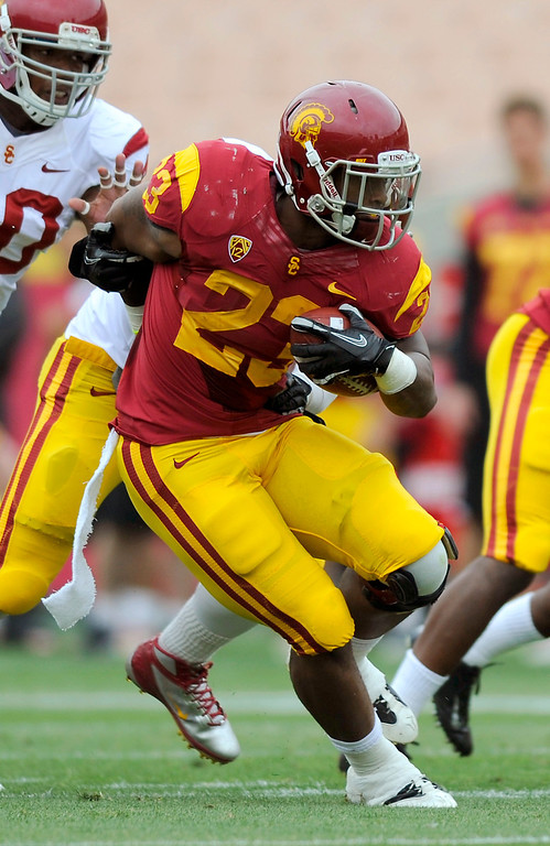 . RB Tre Madden gets into the defensive secondary at USC\'s Spring Football Game. (Michael Owen Baker/Staff Photographer)