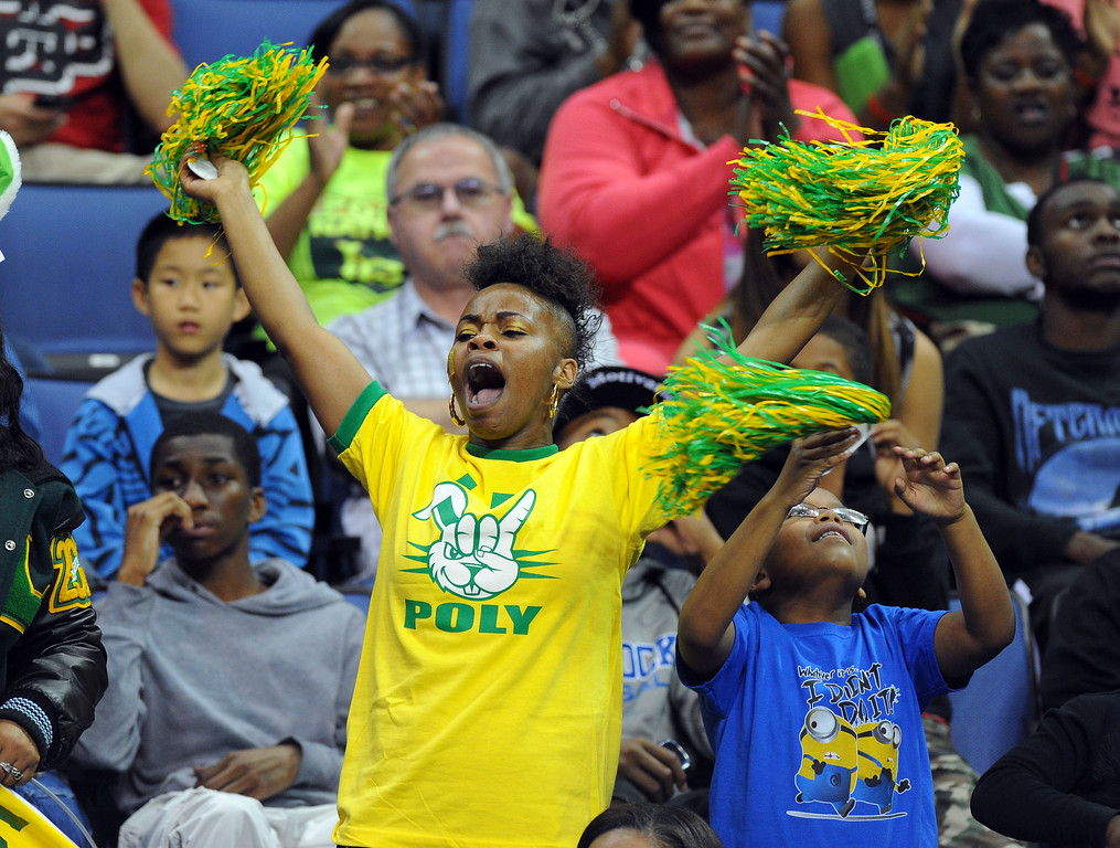. Long Beach Poly fans celebrate their win at Citizens Business Bank Arena in Ontario, CA on Saturday, March 22, 2014. Long Beach Poly vs Etiwanda in the CIF girls open division regional final. 2nd half, Poly won 56-46. Photo by Scott Varley, Daily Breeze)