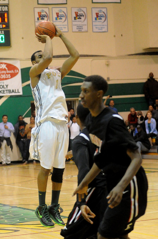 . 02-26-2012--(LANG Staff Photo by Sean Hiller)-Etiwanda beat Long Beach Poly 59-55 in Tuesday\'s CIF Southern Section Division 1AA semifinal boys basketball game at Long Beach Poly High School. Roschon Prince hits three pointer to tie the game and send it to overtime.