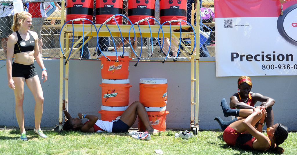 Description of . Athletes cool off after competing during the Mt. SAC Relays in Hilmer Lodge Stadium on the campus of Mt. San Antonio College on Saturday, April 20, 2012 in Walnut, Calif.    (Keith Birmingham/Pasadena Star-News)