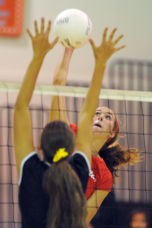 . Redondo girls volleyball takes on Bishop Montgomery in a non league match in Torrance on 09/10/2013. Redondo won 3-0. Redondo\'s Marissa Mitter goes for a spike over a Bishop block. (Photo by Scott Varley, Daily Breeze)