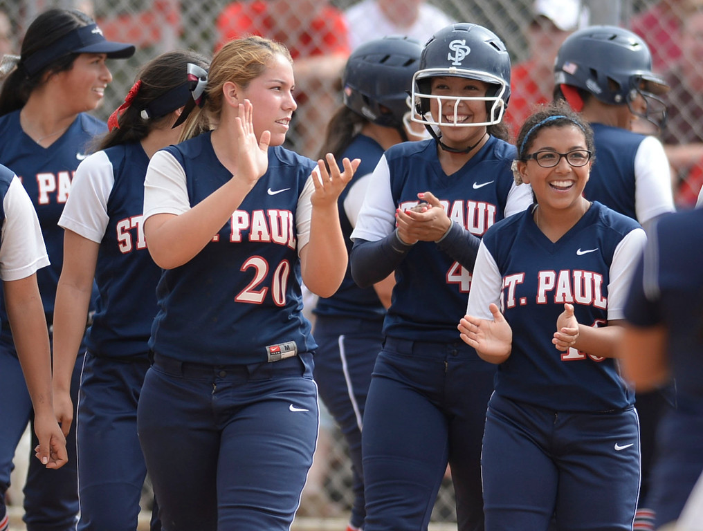 . St. Paul celebrates a grand slam home run against Palos Verdes in a CIF-SS Division III semifinal softball game Tuesday, May 27, 2014, Palos Verdes Estates, CA.   Palos Verdes lost 10-0. Photo by Steve McCrank/Daily Breeze