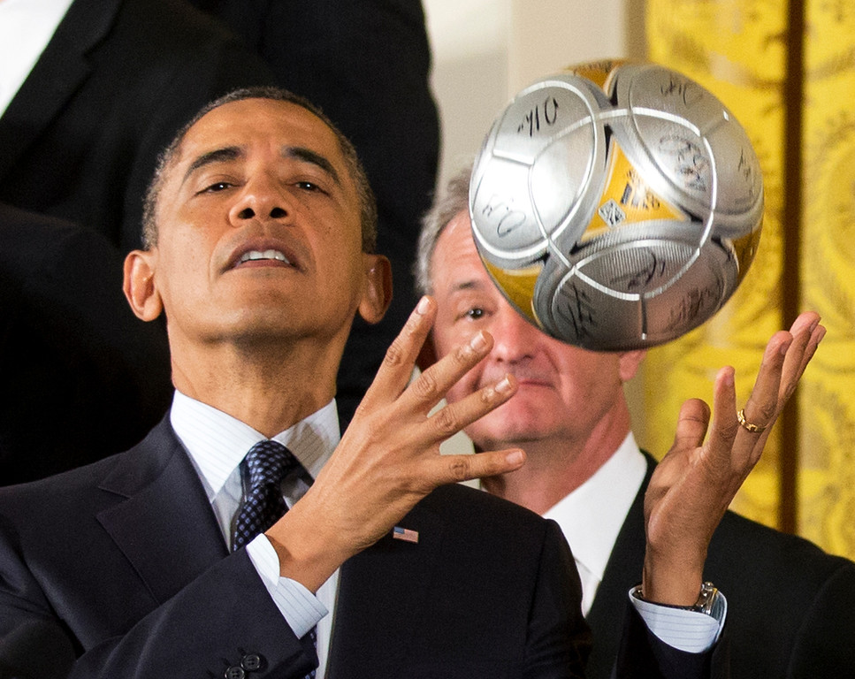 . Los Angeles Kings hockey coach Darryl Sutter, right, watches as President Barack Obama catches the soccer ball after bouncing it off his forehead during a ceremony  in the East Room of the White House in Washington, Tuesday, March 26, 2013, welcoming the Stanley Cup champion Los Angeles Kings and the Major League Soccer champion LA Galaxy, to honor their 2012 championship seasons.   (AP Photo/Manuel Balce Ceneta)