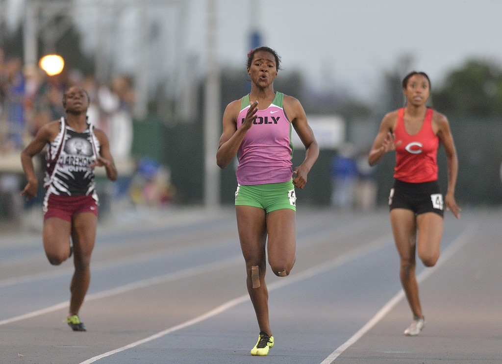 . NORWALK, CALIF. USA -- Poly\'s Arianna Washington competes in the 200 meter dash with Claremont\'s Brittany Brown, left, and Centennial\'s Eboni Sutherland during the CIF-SS Masters Track and Field Meet in Norwalk, Calif., on Friday, May 24, 2013. Photo by Jeff Gritchen / Los Angeles Newspaper Group