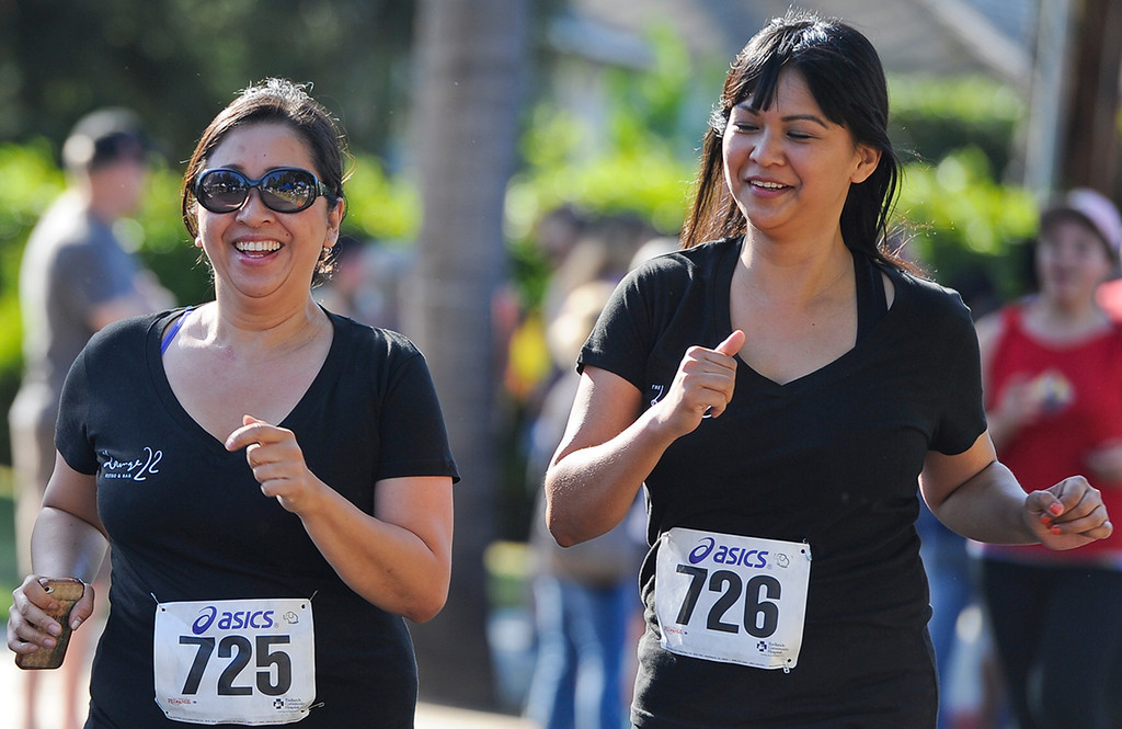 Description of . Runners participate in the 30th annual Run Through Redlands event on Sunday, April 21, 2013. The race proceeds benefited the Kiwanis Club Foundation and scholarship opportunities for high school seniors. (Rachel Luna / Staff Photographer)