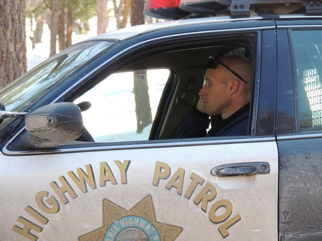 . CHP at the scene of fugitive Christopher Dorner sighting near Highway 38 by Braton Flatts In the San Bernardino Mountains on Tuesday, Feb. 12, 2012. (Rachel Luna / Staff Photographer)