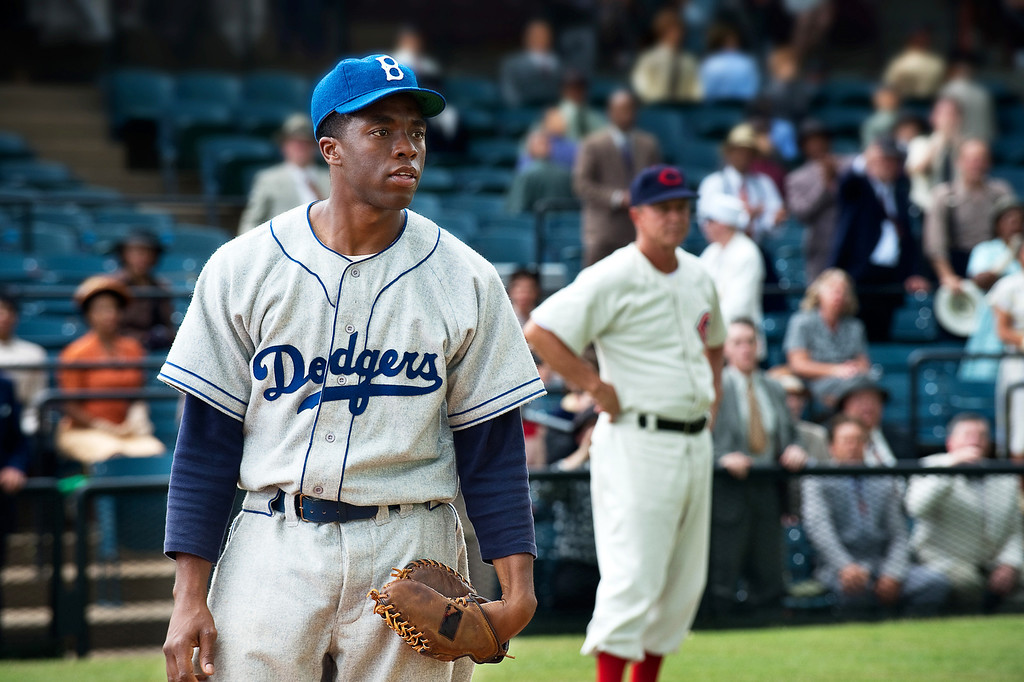 Description of . This film image released by Warner Bros. Pictures shows Chadwick Boseman as Jackie Robinson in a scene from