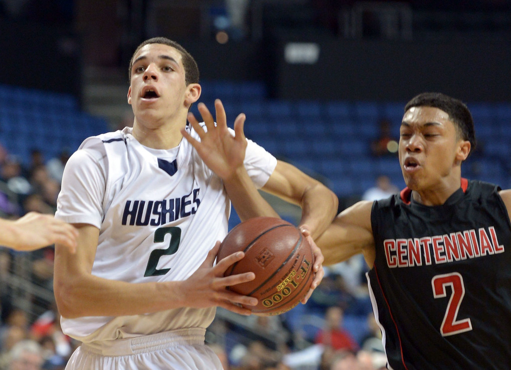 . Chino Hills\' Lonzo Ball has the ball stripped by Centennial\'s Sedrick Barefield at Citizens Business Bank Arena in Ontario, CA on Saturday, March 22, 2014. Chino Hills vs Centennial in the CIF boys Div 1 regional final. 1st half. Photo by Scott Varley, Daily Breeze)