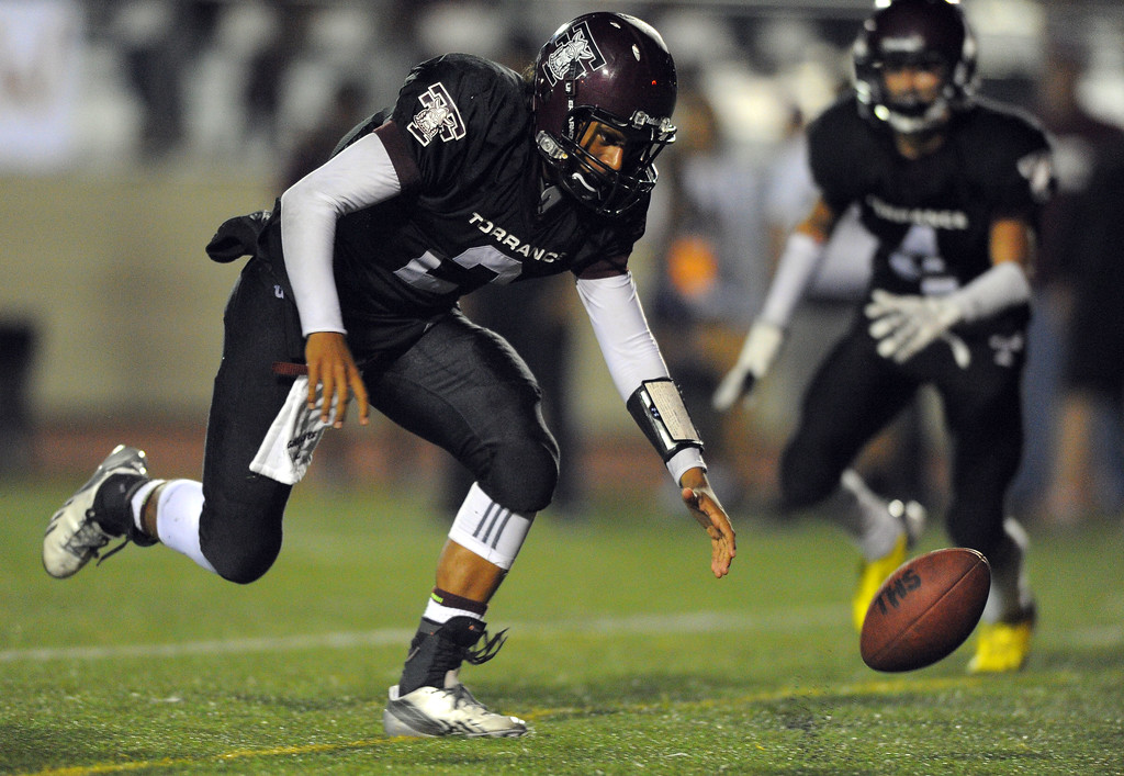 . West High takes on Torrance in a non league football game at Zamperini Stadium in Torrance, CA on Thursday, September 12, 2013. Torrance QB Gabe Gonsalves chases down a ball for a loss that was snapped over his head. (Photo by Scott Varley, Daily Breeze)