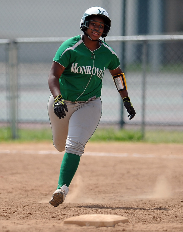 Description of . Monrovia's Derek Blow doubles for a RBI in the third inning of the Northview Tournament championship softball game against Covina at Northview High School on Thursday, April 4, 2013 in Covina, Calif.  Monrovia won 6-0. 