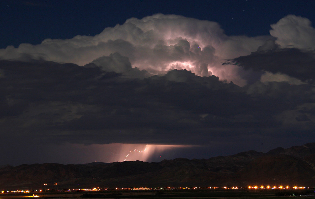 Description of . Lightning strikes and lights up the skies as monsoon storms pass throughout the high deserts area early Monday morning, Aug. 19, 2013 Barstow CA. Photo by Gene Blevins/LA Daily News