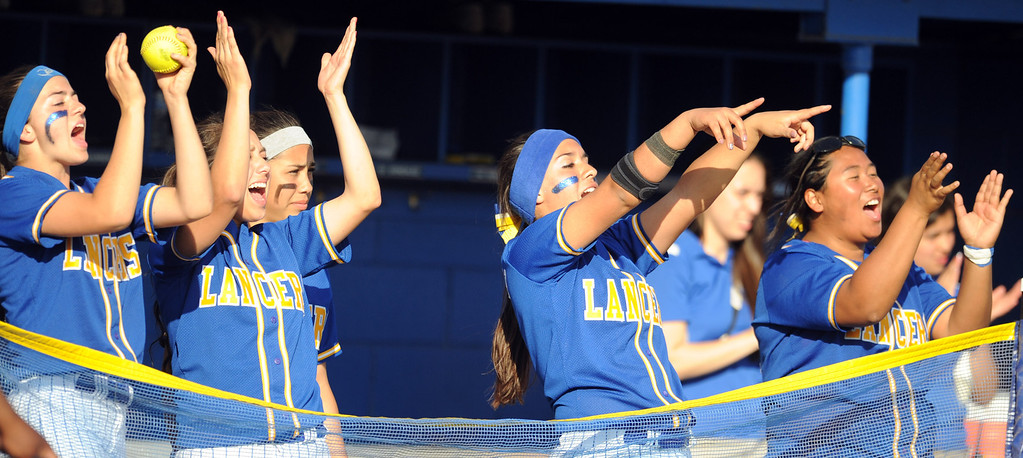 Description of . Bishop Amat bench reacts to Alexis Gonzalez (not pictured) double in the sixth inning of a prep softball game against Santiago at Bishop Amat High School on Wednesday, March 27, 2013 in La Puente, Calif. Bishop Amat won 5-3.  (Keith Birmingham Pasadena Star-News)