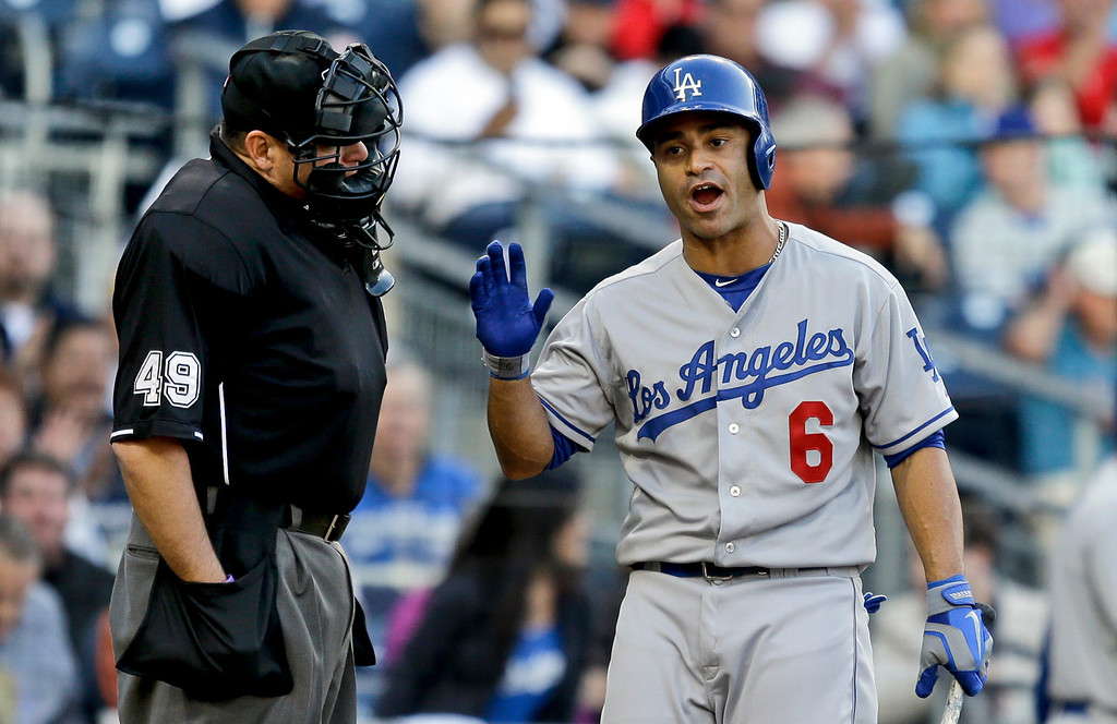 . Los Angeles Dodgers\' Jerry Hairston Jr., argues with umpire Andy Fletcher on his called third strike during the eighth inning of a baseball game against the San Diego Padres in San Diego, Tuesday, April 9, 2013. (AP Photo/Lenny Ignelzi)