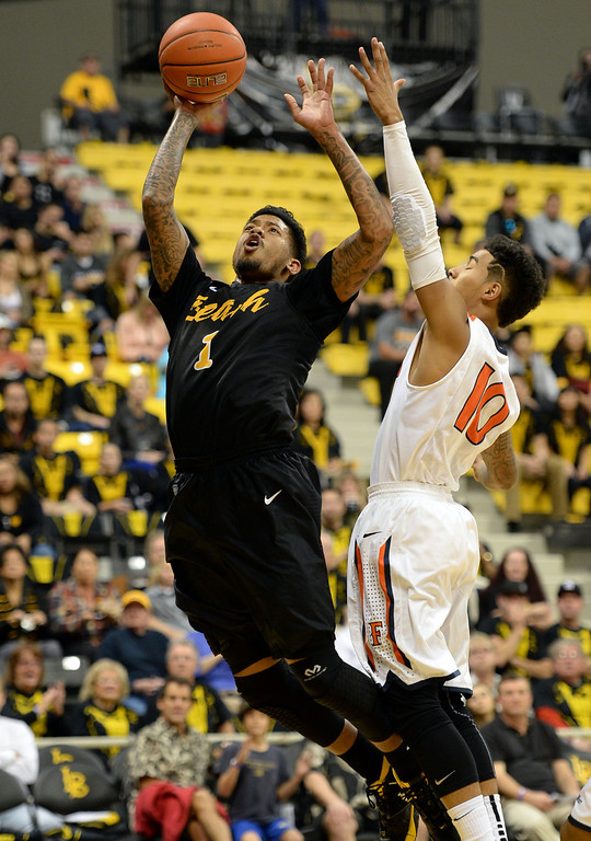 . Long Beach\'s Tyler Lamb (1) makes a leaping shot around Fullerton\'s Michael Williams (10) in a Big West mens basketball game at the Pyramid Saturday, February 01, 2014, Long Beach CA.   Long Beach won 75-56. CSU Long Beach versus CSU Fullerton Photo by Steve McCrank/Daily Breeze