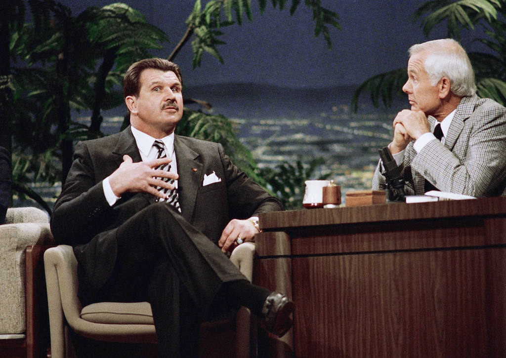 . Chicago Bears football coach Mike Ditka gestures as talk show host Johnny Carson listens during taping of �The Tonight Show Starring Johnny Carson,� in Burbank, Calif., Jan. 20, 1987. Ditka said he would re-evaluate his situation with the Bears at the end of next season. (AP Photo/Mark Avery)