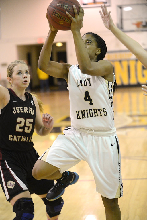 . Bishop Montgomery\'s Chelsea Lidy (4) gets to the basket through JSerra\'s Megan House (25) in a CIF Division IV-AA quarterfinal game Wednesday night in Torrance. No foul was called.  20130220 Photo by Steve McCrank / Staff Photographer