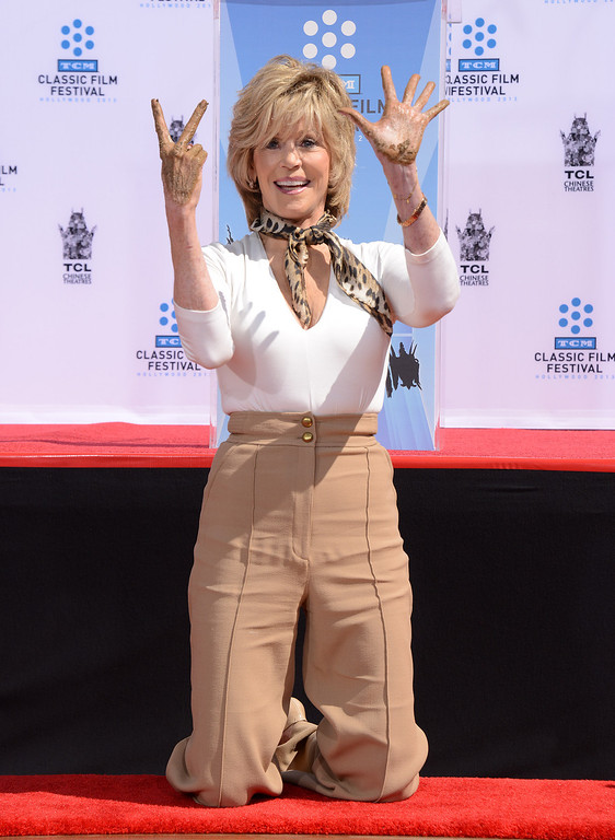 . Jane Fonda poses as the 2013 TCM Classic Film Festival honors Jane Fonda with a handprint and footprint ceremony at the TCL Chinese Theatre on Saturday, April 27, 2013 in Los Angeles. (Photo by Jordan Strauss/Invision/AP)