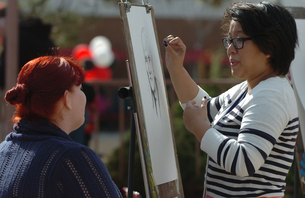 """Description of . Former Chaffey College student Camille Alaras, right 22 of Rancho Cucamonga, draws student Melissa Garcia, 30 of Upland, at the Chaffey College celebrates its """"130th"""" anniversary in Rancho Cucamonga March 9, 2013. (Thomas R. Cordova/Staff Photographer)"""