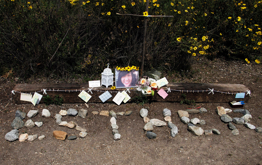 """. Stones are placed to read \""""Esther\"""" at a memorial for Esther Suen, at the start of the hiking trail, at Eaton Canyon Park in Altadena, Monday, March 25, 2013. Esther Suen a 17-year old Mark Keppel High School student fell 200 feet and was killed on a hiking accident on Friday at Eatyon Canyon Park. (Correspondent Photo by James Carbone/SXCITY)"""