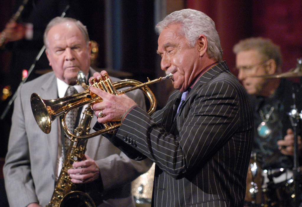 """. In this photo provided by CBS, former Tonight Show Band leader and members Doc Severinsen ,center, Tommy Newsome, left,  and drummer Ed Shaughnessy, right,  play Johnny Carson\'s favorite ballad \""""Here\'s that Rainy Day\"""" during a tribute to Carson taping of the Late Show with David Letterman, New York, Monday Jan. 31, 2005.  (AP Photo/ CBS, JP Filo,HO)"""