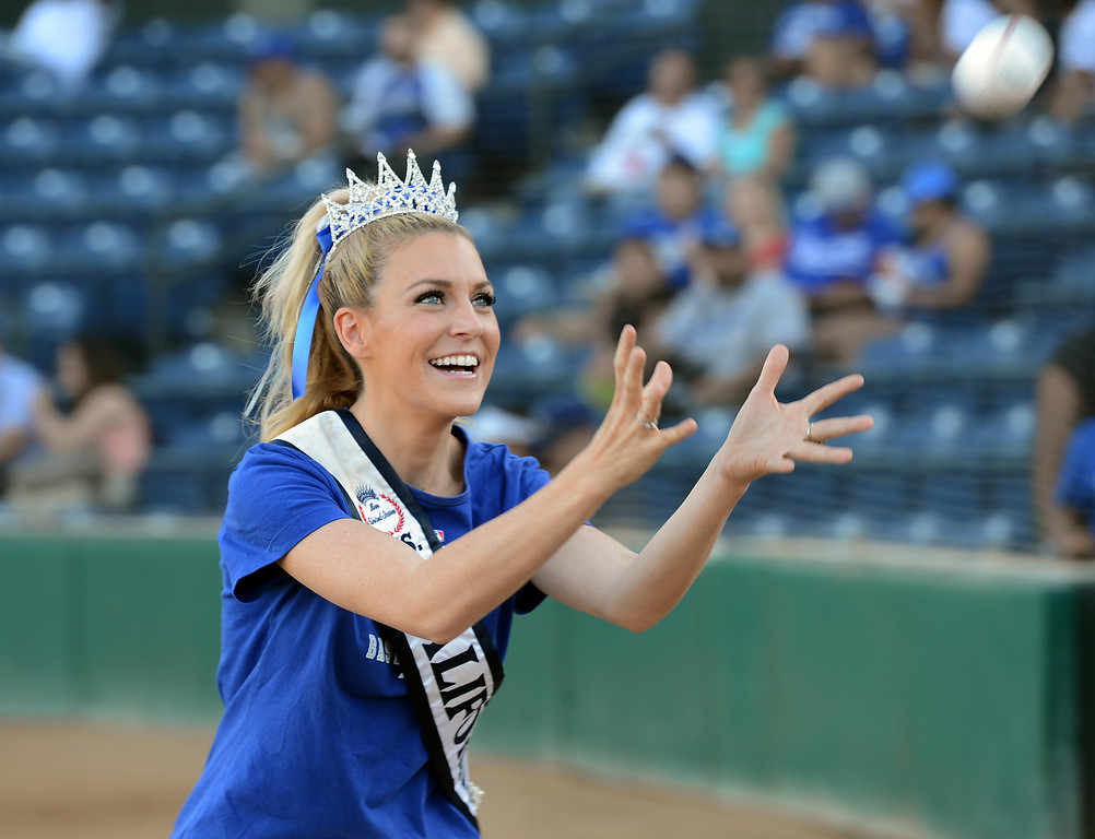 Description of . Ms. California 2014 Sande Charles warms up before throwing out the first pitch at the Quakes game at LoanMart Field in Rancho Cucamonga, CA, Friday, August 15, 2014. (Photo by Jennifer Cappuccio Maher/Inland Valley Daily Bulletin)