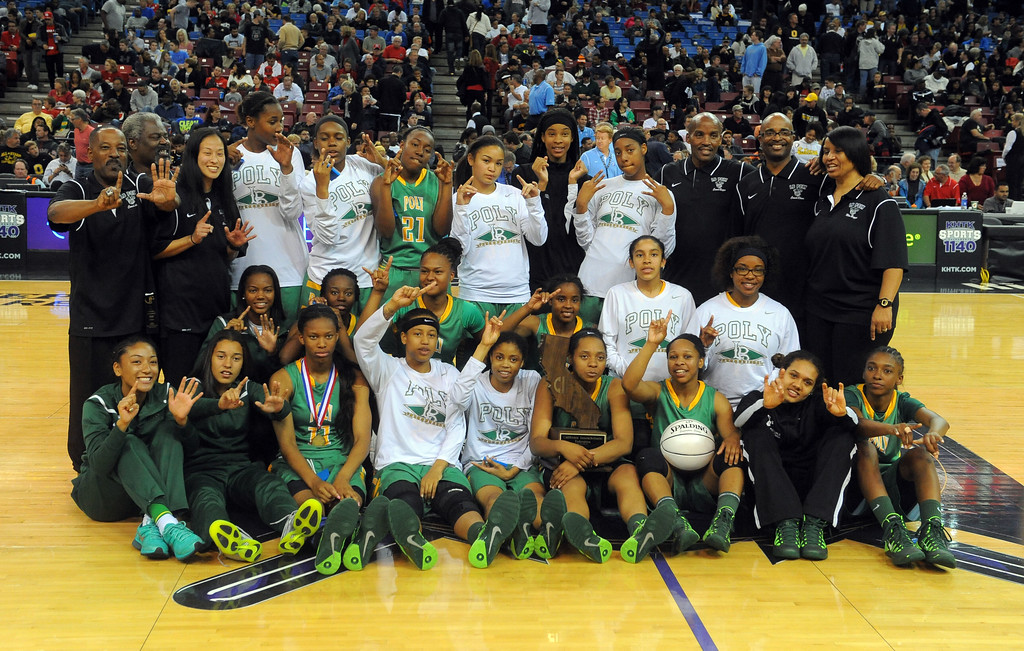. Long Beach Poly celebrates their 6th state title at Sleep Train Arena in Sacramento, CA on Saturday, March 29, 2014. Long Beach Poly vs Salesian in the CIF Open Div girls basketball state final. 2nd half. Poly won 70-52. (Photo by Scott Varley, Daily Breeze)