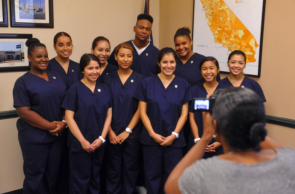 . 10 recent high school graduates who received their Certified Nursing Assistant certificates at the Goodwill, pose for photographs in Long Beach, CA on Friday, August 22, 2014. The students; Gabriela Avila, Averianna Burnett, Alesia Clay, Ariana Mays, Kendra Montano, Silvia Monzon, Genesis Perez, Cindia Sanchez, Daniel Scott and Dahlia You completed the year-long course in a partnership between the LBUSD and Goodwill. This is the first year that the state Certified Nurse Assistant Training Academy program has been free for the students. It was announced to the families and friends gathered that all 10 of the graduates have health care job interviews next week. (Photo by Scott Varley, Daily Breeze)