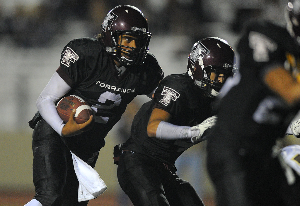 . West High takes on Torrance in a non league football game at Zamperini Stadium in Torrance, CA on Thursday, September 12, 2013. West won 46-7. Torrance QB Gabe Gonsalves follows his blockers for a run that set up a 3rd qtr TD. (Photo by Scott Varley, Daily Breeze)