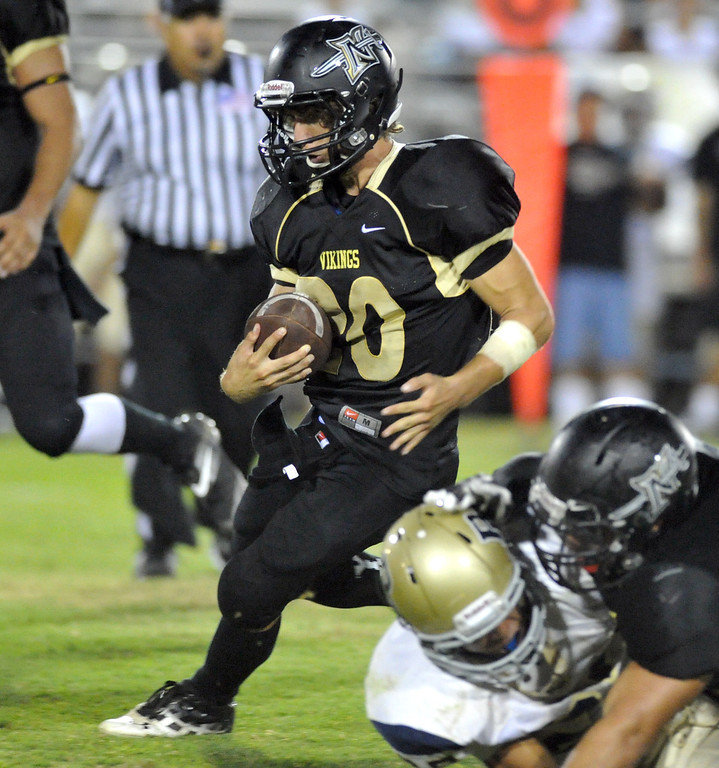 Description of . Northview's Damian Lavin (#20) gains yardage on a run as they play Rowland in their non-league game at Covina District Field in Covina on Friday September 13, 2013. Northview beat Rowland 28-0. (San Gabriel Valley Tribune/Staff Photo by Keith Durflinger)