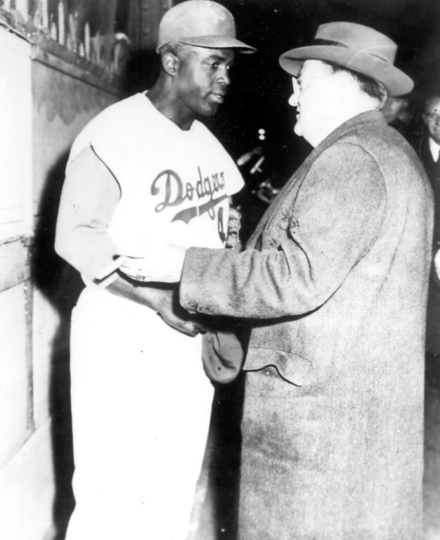 Description of . Jackie Robinson with Dodgers' owner Walter O'Malley.  Daily News file photo