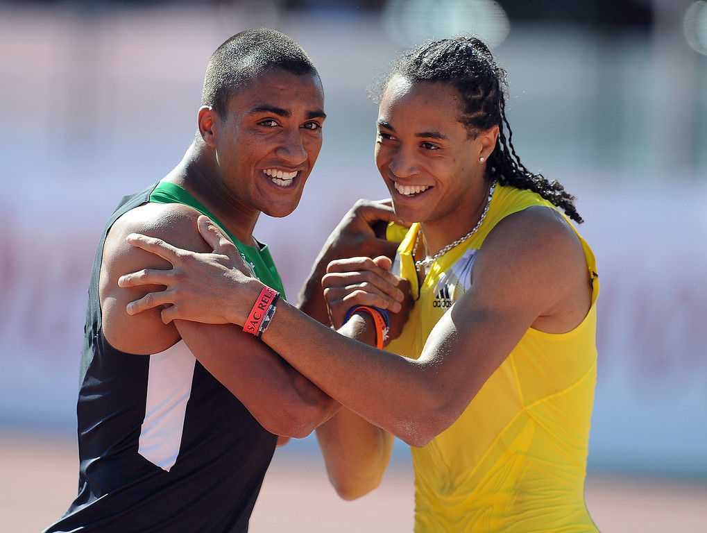 Description of . Ashton Eaton, left,  finished third in the 110 meter hurdles invitational elite shakes hands with Pascal Martinot-Lagarde of France who finished second during the Mt. SAC Relays in Hilmer Lodge Stadium on the campus of Mt. San Antonio College on Saturday, April 20, 2012 in Walnut, Calif.    (Keith Birmingham/Pasadena Star-News)