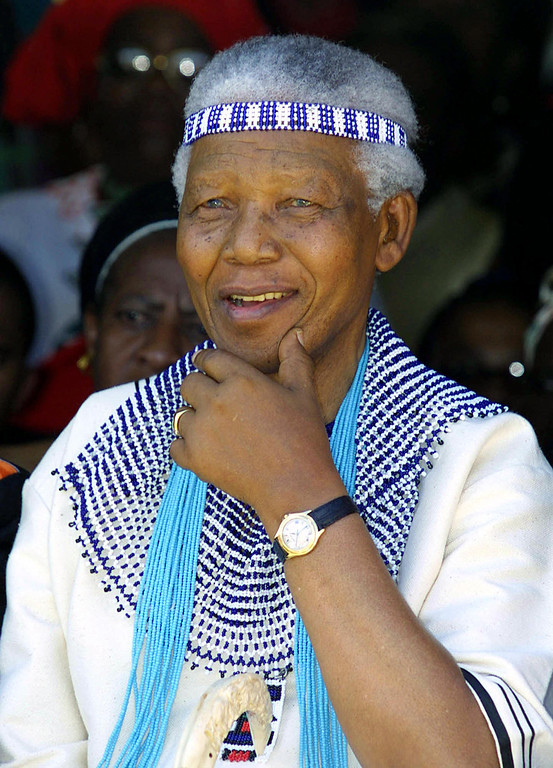 . Former South African President Nelson Mandela, wearing traditional Xhosa dress as a member of the Tembu Royal family, attends the wedding of his great grand nephew, Prince Mfundo Mtirarar, 07 December 2002 in Umtata, Eastern Cape Province.    (RAJESH JANTILAL/AFP/Getty Images)