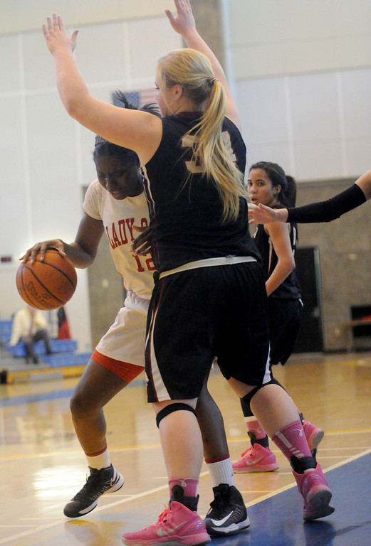 . 03-12-2013--(LANG Staff Photo by Sean Hiller)-Serra\'s Tatiana Howard (12) is overpowered by JSerra\'s Courtney Vaccher (34) in Tuesday\'s girls basketball IV Southern California Regional semifinal at L.A. Southwest College.
