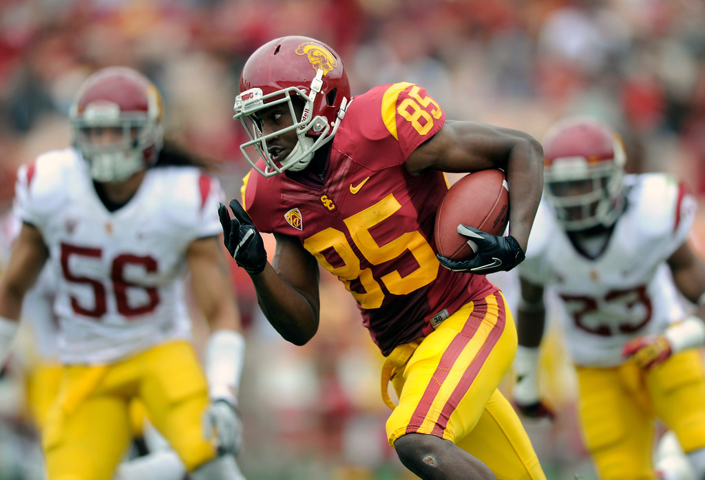. WR Victor Blackwell runs for yardage after a pass reception during USC\'s Spring Football Game at the L.A. Memorial Coliseum, Saturday, April 13, 2013. (Michael Owen Baker/Staff Photographer)