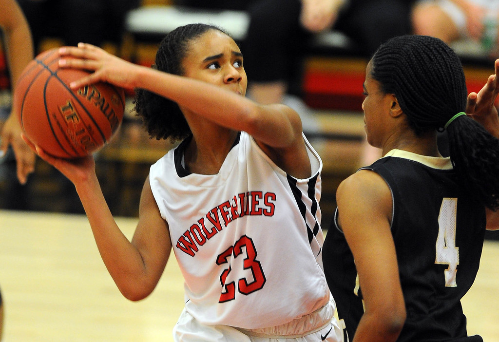 . STUDIO CITY - 02/16/13 - (Photo: Scott Varley, Los Angeles Newspaper Group)  CIF Southern Section Division IV-AA second-round girls basketball playoff game. Bishop Montgomery vs Harvard-Westlake. Bishop Montgomery won 57-42. H-W\'s Jordan Brown looks for a shot around Chelsea Lidy.