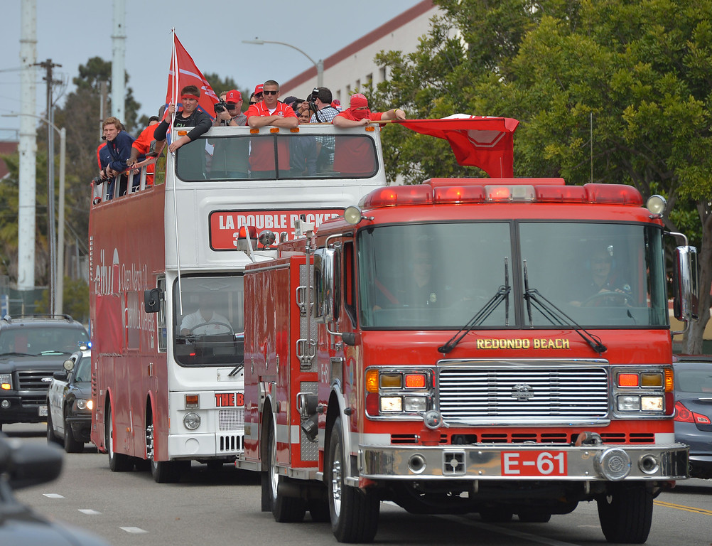 . TBR29-RUHS_PARADE--- Redondo Beach, CALIFORNIA--3/28/13--- Staff Photo: Robert Casillas / LANG---  The Redondo Union High basketball team was celebrated Thursday for their CIF State title. The festivities began with a double decker bus ride around the school and a rally at City Hall.  Players ride bus down Diamond St.