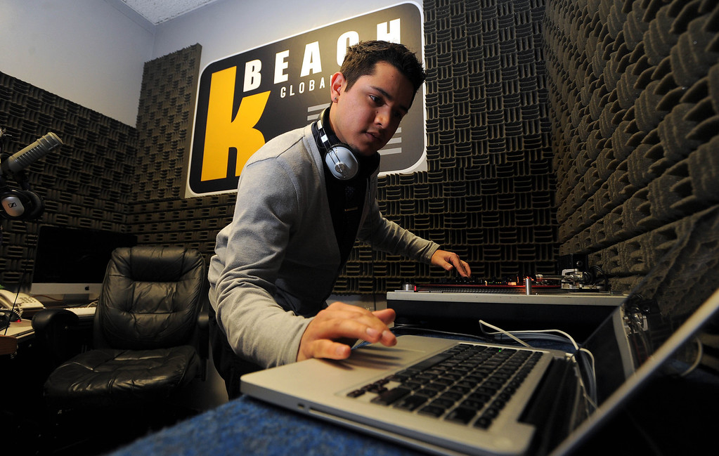 . LONG BEACH - 02/13/13 - (Photo: Scott Varley, Los Angeles Newspaper Group)  CSULB launched their new student-run radio station Wednesday afternoon. KBeach will broadcast on 88.1 FM HD3. After taking the station live, DJ Joe Kay begins a shift in the booth spinning records. Kay\'s regular show will air Fridays 1-4 p.m.