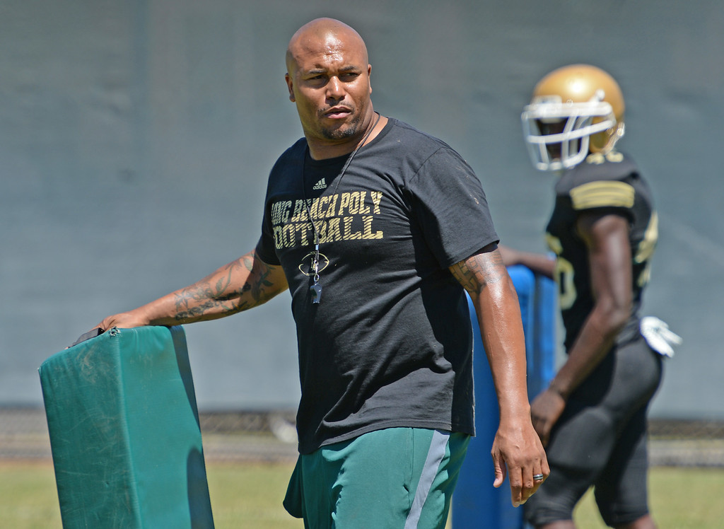 . Long Beach Poly football coach Antonio Pierce during practice Saturday, August 16, 2014, Long Beach, CA.   Photo by Steve McCrank/Daily Breeze