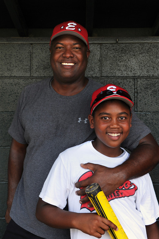 . Encino\'s 11-under all-star baseball assistant coach Rodney Peete with his son Robinson Peete. (Michael Owen Baker/L.A. Daily News)