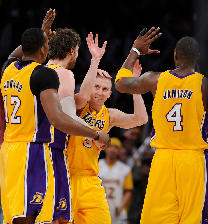 . Lakers#5 Steve Blake is congratulated on his 3 pointer late in the 4th quater that put the Lakers ahead. The Lakers defeated the Houston Rockets in overtime 99-95 in the final home game of the year at Staples Center in Los Angeles, CA 4/17/2013(John McCoy/Staff Photographer