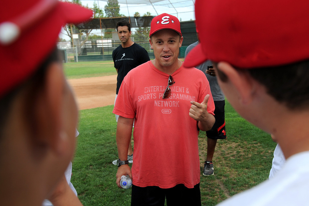 . Head coach Kevin Dicker talks with players from Encino\'s 11-under all-star baseball team, which is competing in the Southern California tournament final Saturday in San Diego. (Michael Owen Baker/L.A. Daily News)