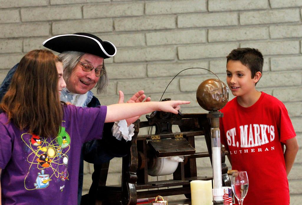 Description of . Alexis Chernin, 11, left, and Lucas Valero, 10, assist Benjamin Franklin with his
