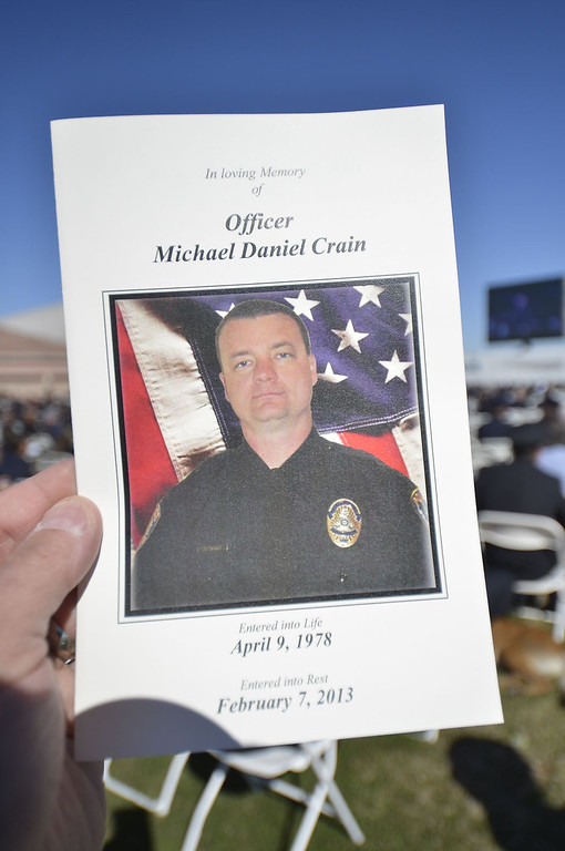 Description of . Thousands of people, including law enforcement officials from across the state, arrived at the Grove Community Church this morning to attend the funeral service for Riverside Police Officer Michael Crain. Numerous California law enforcement joined all 400 members of the Riverside Police Department during the procession for Crain, 34, who was killed Feb. 7 when a suspect believed to be Christopher Dorner ambushed him and his partner while on duty.  (Jeff Gritchen/Staff Photographer)
