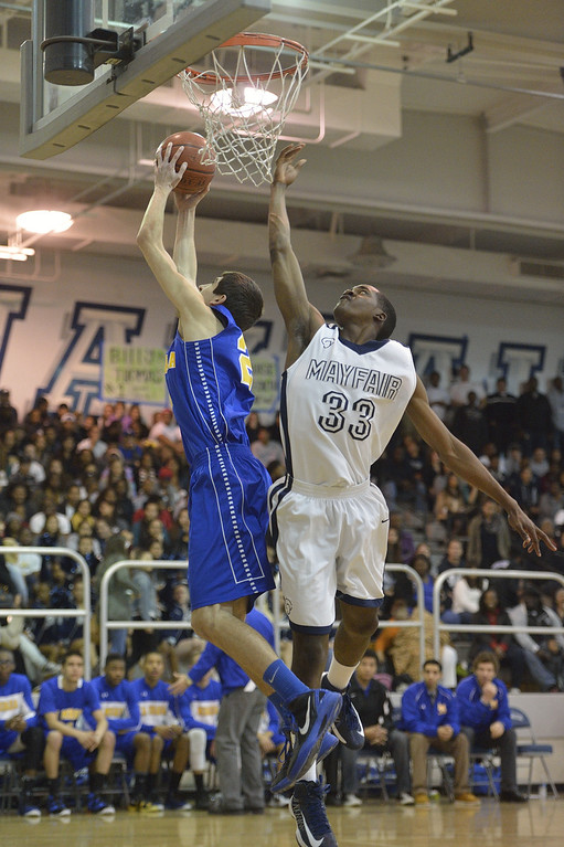 . LAKEWOOD, CALIF. USA -- Mayfair\'s Eze Egeonuigwe (33) and La Mirada\'s Charlie Reid (21) go after a rebound in Lakewood, Calif., on February 8, 2013. Mayfair defeated La Mirada 60 to 59. Photo by Jeff Gritchen / Los Angeles Newspaper Group