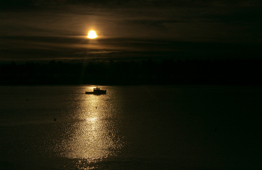 . A lobster boat heads out to sea on a calm winter\'s morning, Thursday, Feb. 14, 2013, in Freeport, Maine. (AP Photo/Robert F. Bukaty)