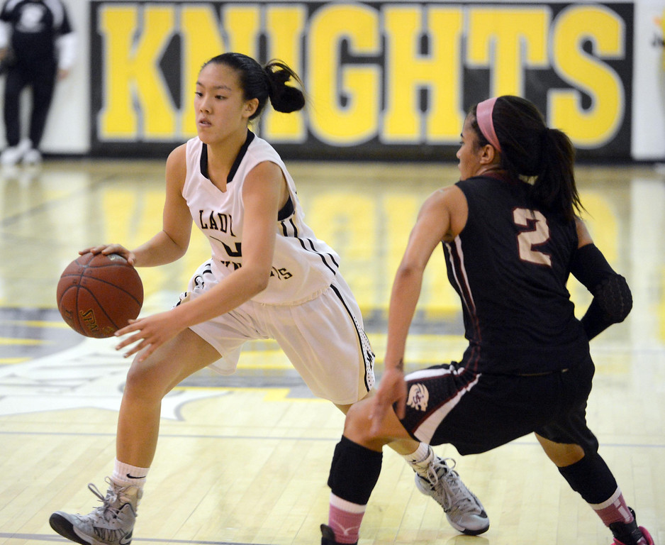 . Bishop Montgomery\'s Sophia Song (24) drives to the key around  JSerra\'s August Touchard (2) in a CIF Division IV-AA quarterfinal game Wednesday night in Torrance. 20130220 Photo by Steve McCrank / Staff Photographer