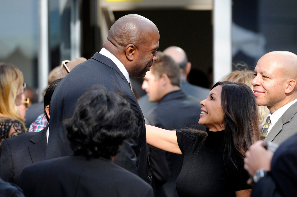 . Magic Johnson is greeted outside the Jerry Buss Memorial Service at Nokia Theatre, Thursday, February 21, 2013. (Michael Owen Baker/Staff Photographer)