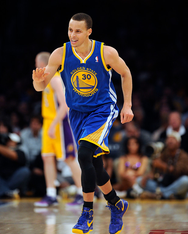 . The Warriors\' Stephen Curry #30 reacts after hitting a 3-pointer during their game against the Lakers at the Staples Center in Los Angeles Friday, April 12, 2013. (Hans Gutknecht/Staff Photographer)