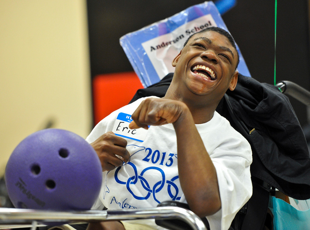 Description of . Student Eric Smith, 15, laughs as he bowls during the annual olympic games at Anderson School in San Bernardino on Friday, March 15, 2013. Students with special needs were involved in activities including a relay race, long jump, kickball and more. (Rachel Luna / Staff Photographer)