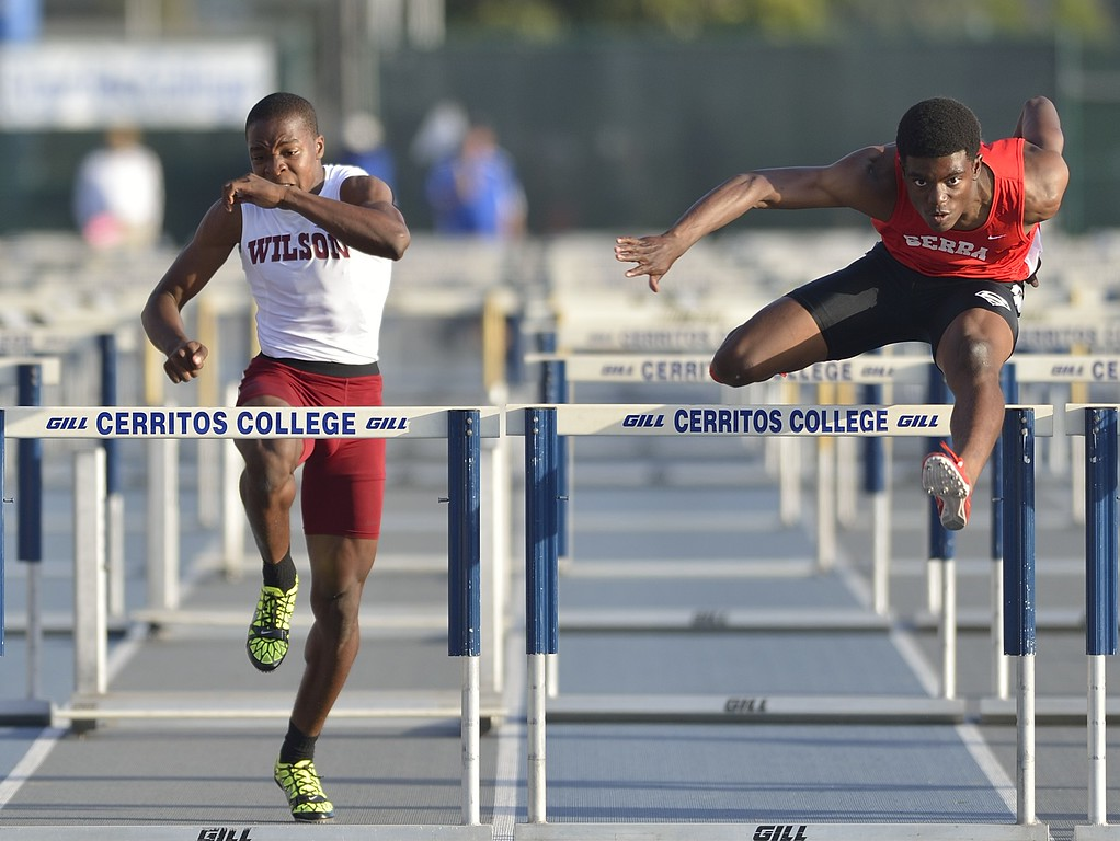 . NORWALK, CALIF. USA -- Wilson\'s Bayron Manuel, left, and Serra\'s Lloyd Siscard compete in the 110 hurdles during the CIF-SS Masters Track and Field Meet in Norwalk, Calif., on Friday, May 24, 2013. Photo by Jeff Gritchen / Los Angeles Newspaper Group